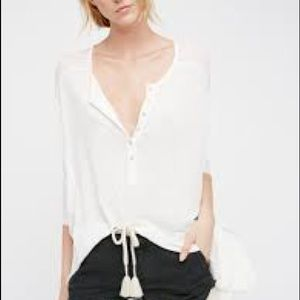 Free people size medium cream colour blouse.